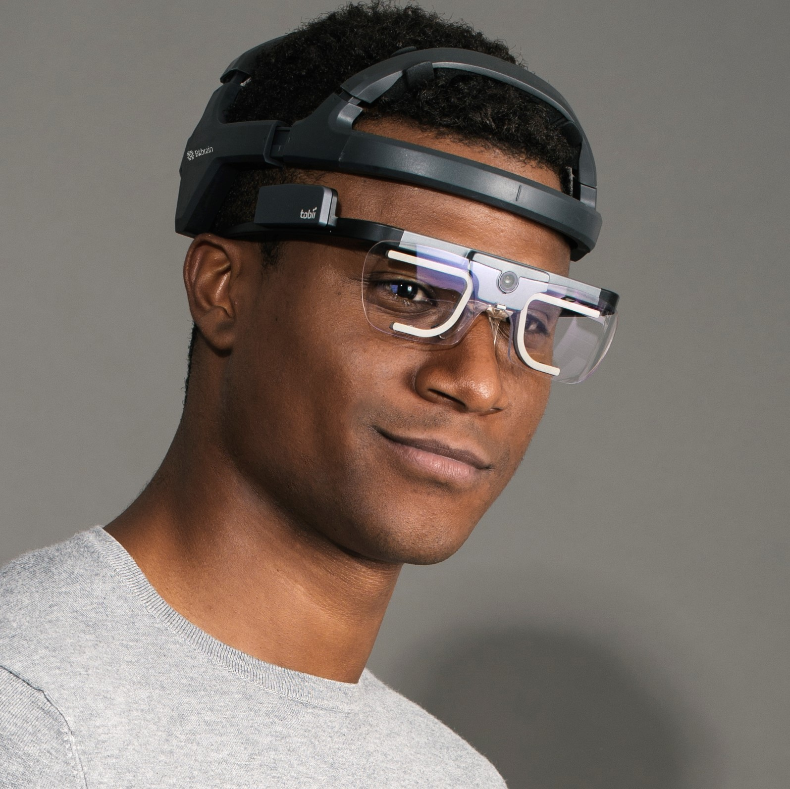 man wearing head-mounted eye tracking device