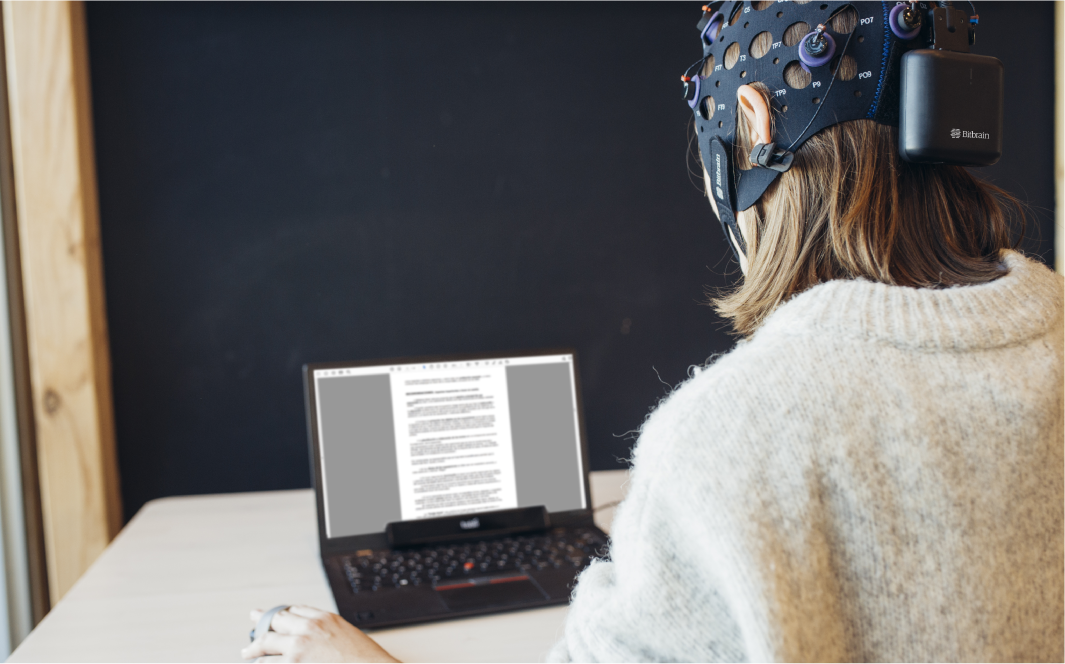 participant in a linguistics research experiment wearing eeg