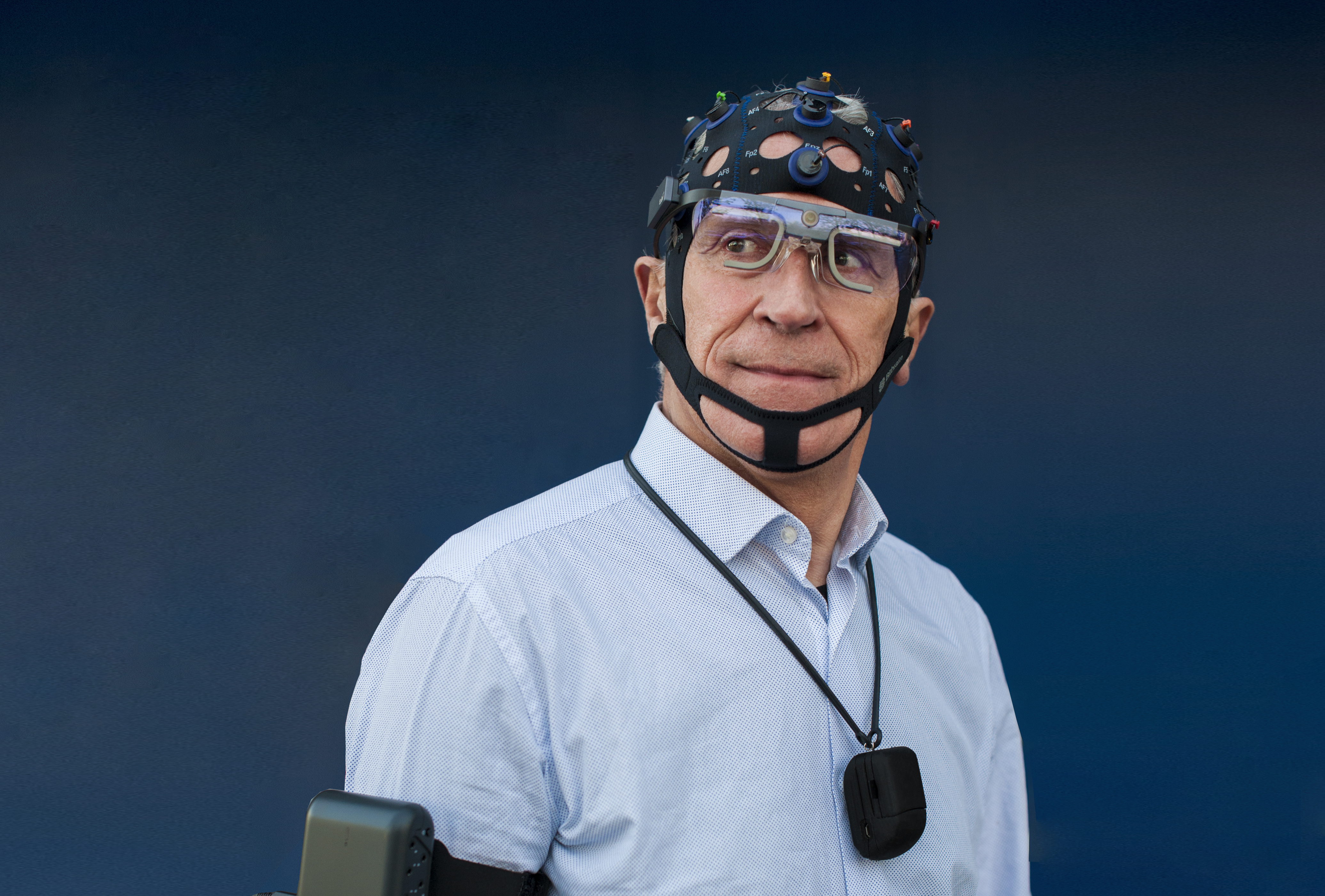 man wearing wireless EEG cap for real world research