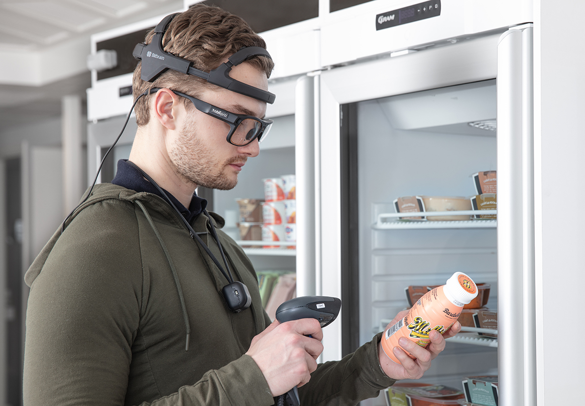 Participant wearing Tobii Pro Glasses 3, Bitbrain Diadem, and Bitbrain InTrack in a point of sale st