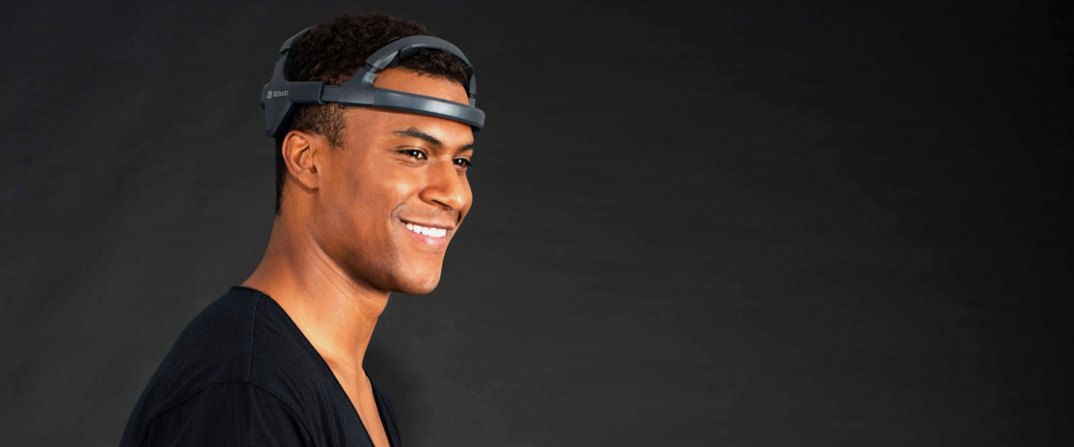 Man smiling with a comfortable dry eeg headset