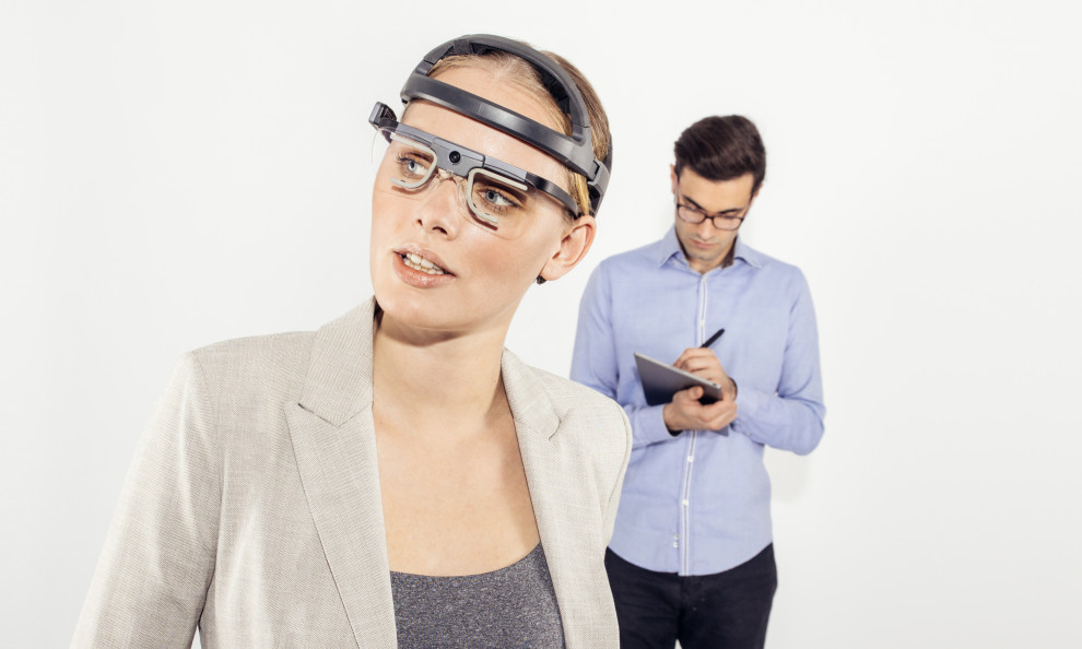 girl wearing eye tracking glasses and eeg for human behaviour research