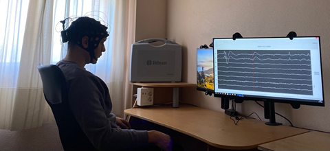 Figure 3: Subject exposed to visual stimuli (left monitor) in a CyberBrain experiment