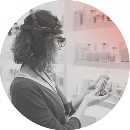 Woman doing a neuromarketing study in a supermarket while looking at the packaging of a product wearing eye tracking, eeg, gsr to know the consumer unconscious emotions