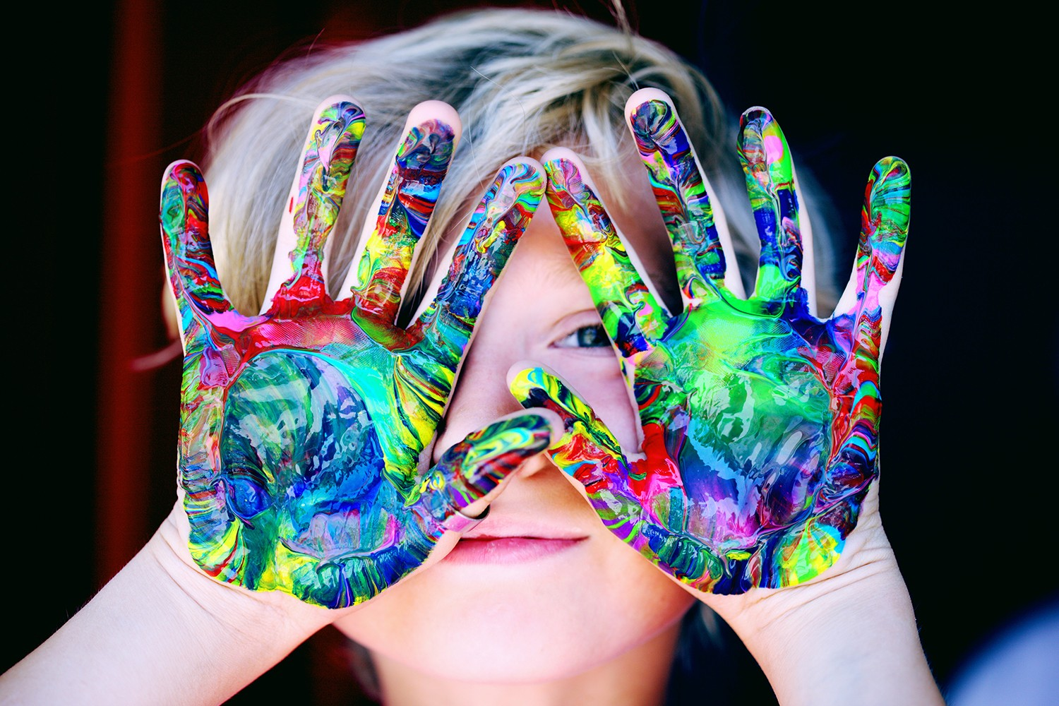 Child with ADHD hyperactivity and inattention that paints and performs a cognitive stimulation game